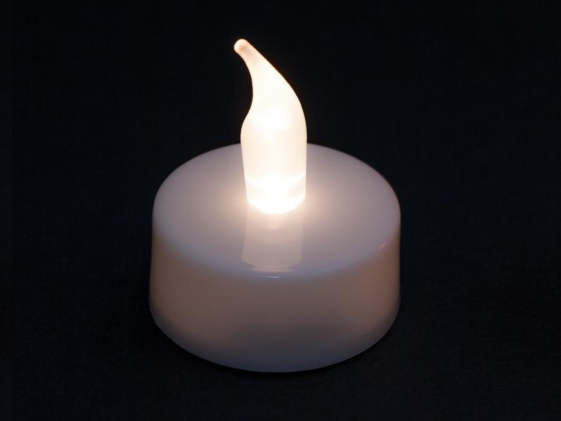 خرید اینترنتی شمع LED شناور روی آب 4 عددی
